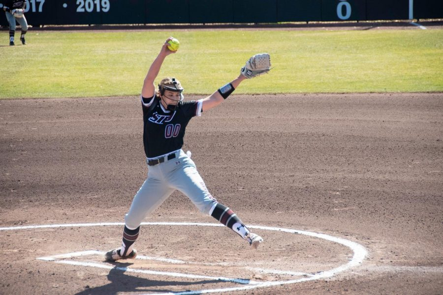 Saluki pitcher, Carlee Jo Clark (00), winds up a pitch during the game against University of Illinois at Chicago on Sunday March 7, 2021 at SIU.