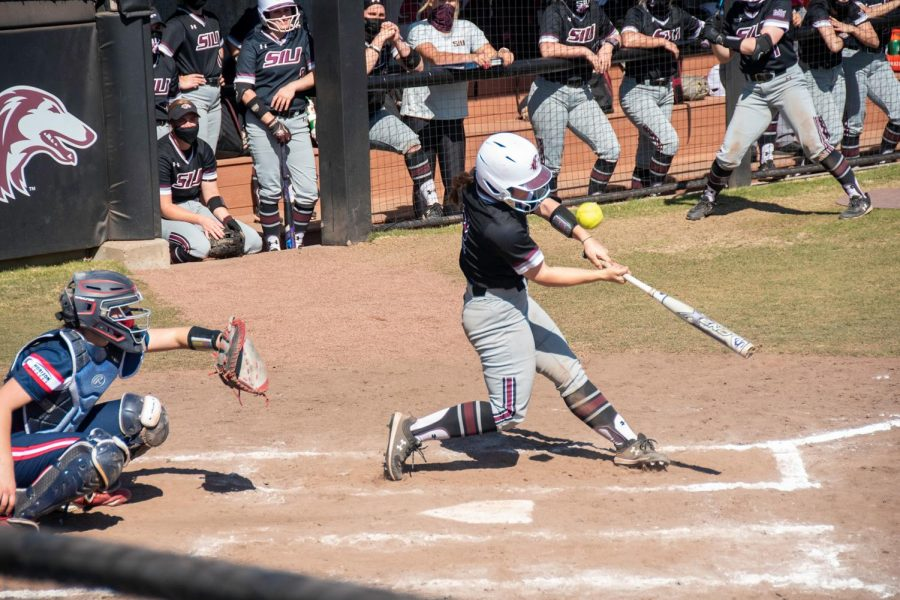 Catcher Sidney Sikes (2) swings at the ball during the game against University of Illinois at Chicago on Sunday March 7, 2021 at SIU.