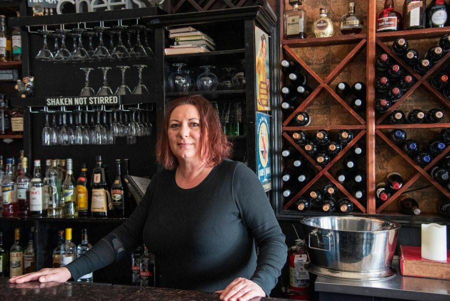 """Andrea Barclay, 52, poses at the bar in her restaurant, Global Gourmet, on Friday, March 12, 2021in Carbondale Ill. She has been in the food industry since 1993. Barclay says since owning a restaurant she hasn't encountered and incidents against her being a woman owner. """"Having people work under me, as the boss, I've never had an incident where I was treated differently because I am a female,"""" Barclay said."""