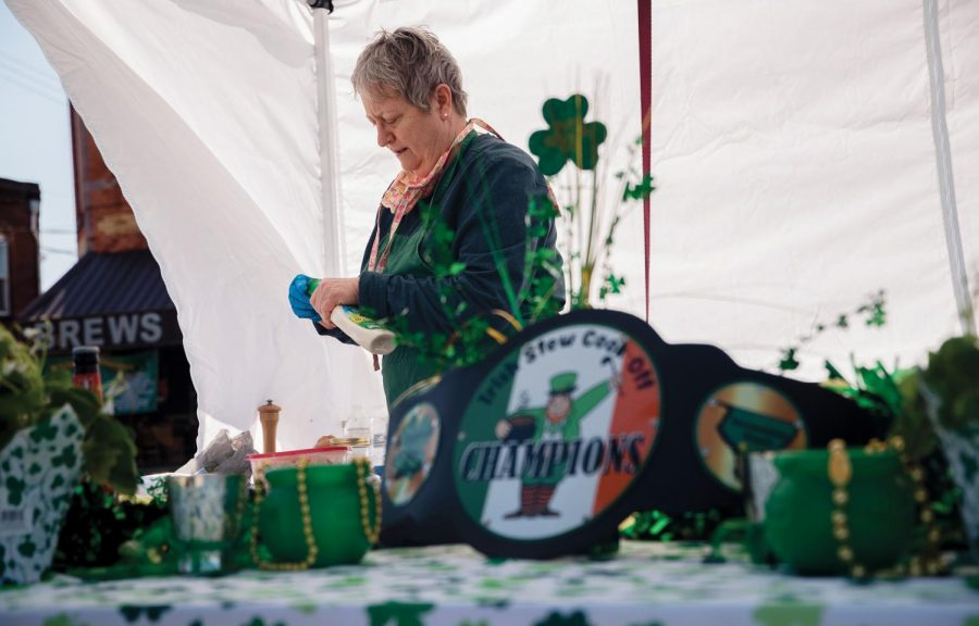 """Lisa Miluer, a Murphysboro resident and winner of the Irish Stew Competition in 2020, prepares her recipe on Saturday March 20, 2021, on Chestnut Street in Murphysboro Ill. She has now been participating in the competition for four continuous years. """"I just enjoy doing this so much so here I am,"""" Miluer said."""