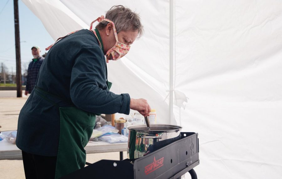 Lisa Mileur, a Murphysboro resident, cooks stew for the Irish Stew Competition at the St. Patrick's Day Festival on Saturday March 20, 2021, in Murphysboro Ill.
