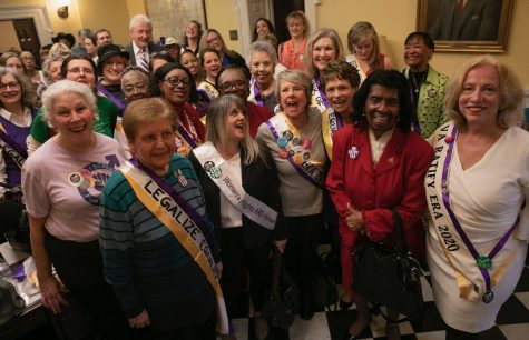 An overflow crowd of supporters of the Equal Rights Amendment wait to be allowed into the gallery of the House of Delegates Wednesday, Jan. 15, 2020 in Richmond, Virginia.