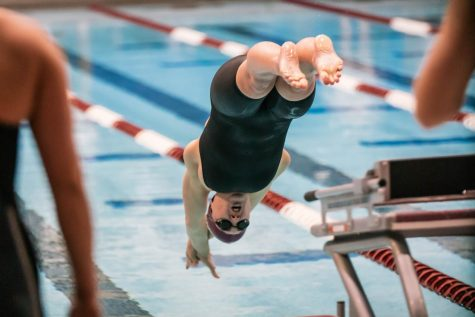 SIU junior, Anna Stephan, dives into the water in a meet against Missouri State University Saturday, Mar. 6, 2021 at the SIU Student Recreation Center.
