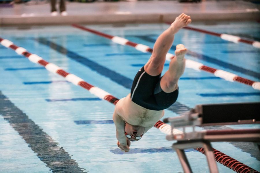 SIU sophomore, Max Ransom, dives in a meet against Missouri State University Saturday, Mar. 6, 2021 at the SIU Student Recreation Center. Ransom specializes in the butterfly and freestyle events.