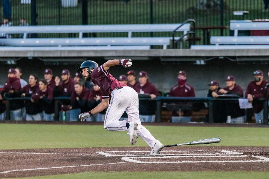Tristan Peters (6) hits a single and runs to first in game one against the Little Rock Trojans Friday, March 26, 2021 at SIU. Peters' hit allowed two runners to make it home.