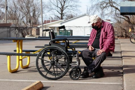 "A Homeless military veteran, who did not wish to give his name, sits outside of the Carbondale Warming Center Feb. 25, 2021, in Carbondale, Ill. ""Most people here have got some kind of story,"" he said. Sophie Whitten 
