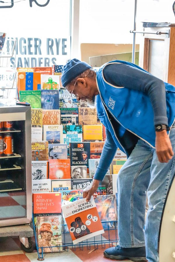 Abdul Rahim Khalil displays his favorite books in his store, Rahim's Beauty Supply, Mar. 1, 2021, in Carbondale, Ill. Khalil said some of his books helped him through his darkest times to persevere. He said he learned a lot of what he knows now because of the books he has read.