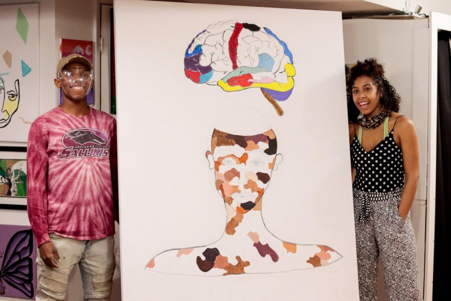 The untitled Art Reconciliation project is unveiled March 13, 2021, at Project Human X in Carbondale, Ill. The painting was sketched by Cree Sahidah Glanz and contributed to by over thirty community members. Each person could add to a patch of skin color or part of the brain. The different skin colors represents the unity of every race and the floating brain represents a higher understanding of the community and world around us.