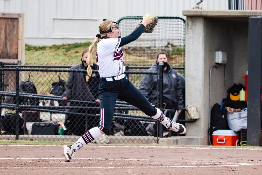 Pitcher, Sarah Harness, winds up a pitch to Northern Kentucky University March 5, 2021, in Carbondale, Ill.