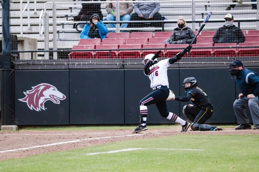 Sophomore, Kerrigan Gamm, winds up the bat against a pitch by Northern Kentucky University Mar. 5, 2021, at Charlotte West Stadium in Carbondale, Ill.