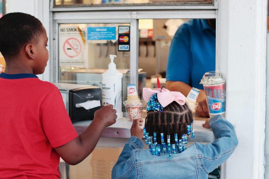 Braylin Bostic and Kimora Brown receive their ice cream March 8, 2021, at Dairy Queen in Carbondale, Ill. Bostic and Brown said they begged to go get ice cream because they love the Dairy Queen in Carbondale.