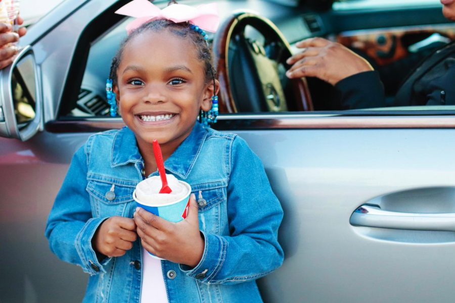Kimora Brown holds up her Dairy Queen Blizzard March 8, 2021, in Carbondale, Ill. Brown said she loves coming to Dairy Queen and eating the ice cream with her family.