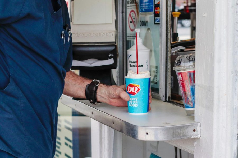 "Dana Penrose receives his order at Dairy Queen March 11, 2021, in Carbondale, Ill. Penrose said that he loves the customer service at the Carbondale Dairy Queen and it always makes him excited to come back. ""They're so good to me. [Sandra Bollinger] hasn't seen me yet this year and she said, 'You want the Hawaiian?' and I said, 'Yeah.' She already knew,"" Penrose said."