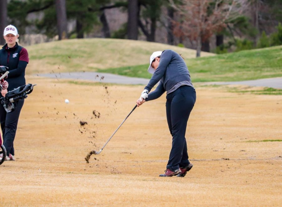SIU senior, Rose Bundy, pitches the ball toward the green March 14, 2021, at Hickory Ridge Golf Course in Carbondale, Ill.