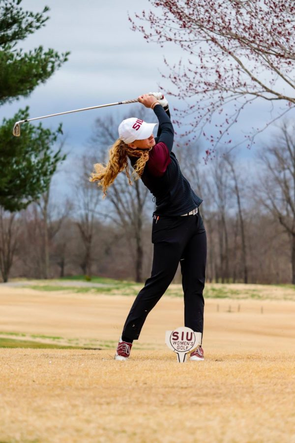 Erica Kerr tees off at the Battle Between Southern and Bradley Mar. 14, 2021, at Hickory Ridge Golf Course in Carbondale, Ill.
