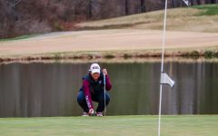 SIU senior, Moyea Russell, evaluates the green during the match against Bradley University Mar. 14, 2021, at Hickory Ridge Golf Course in Carbondale, Ill.