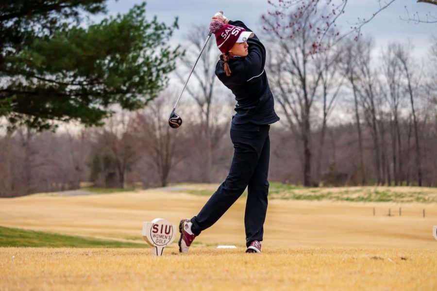 SIU sophomore, Amelia Lawson, drives the ball toward the green during the match against Bradley University March 14, 2021, at Hickory Ridge Golf Course in Carbondale, Ill.