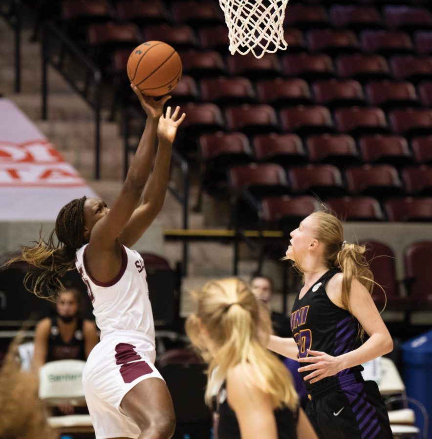 Awa Keita (35) tries to score during the first half of the game against the Northern Iowa Panthers on Friday, Mar. 5, 2021 at the SIU Banterra Center in Carbondale, Ill.