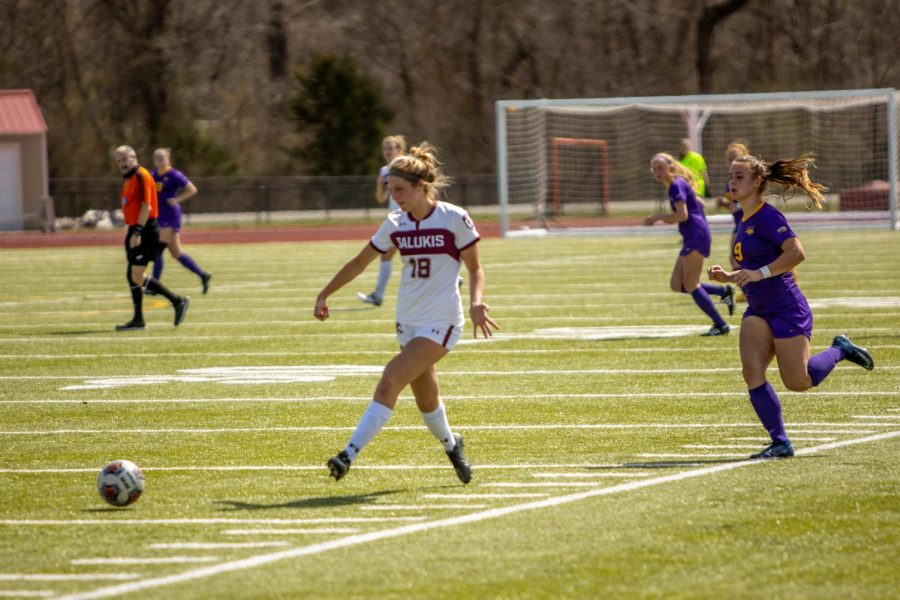 Ashlyn Henrie moves the ball down the field during the game vs. UNI on Sunday, March 21, 2021 in Carbondale, Ill.
