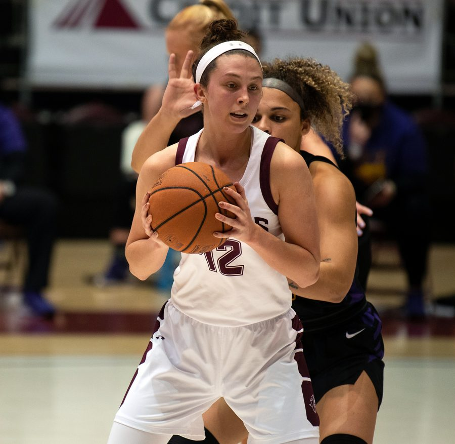 Makenzie Silvey (12) guards the ball in the game against Northern Iowa Panthers on Friday, Mar. 5, 2021 at the SIU Banterra Center in Carbondale, Ill. SIU went on to lose with the score 56-67. Monica Sharma | @mscli_cks