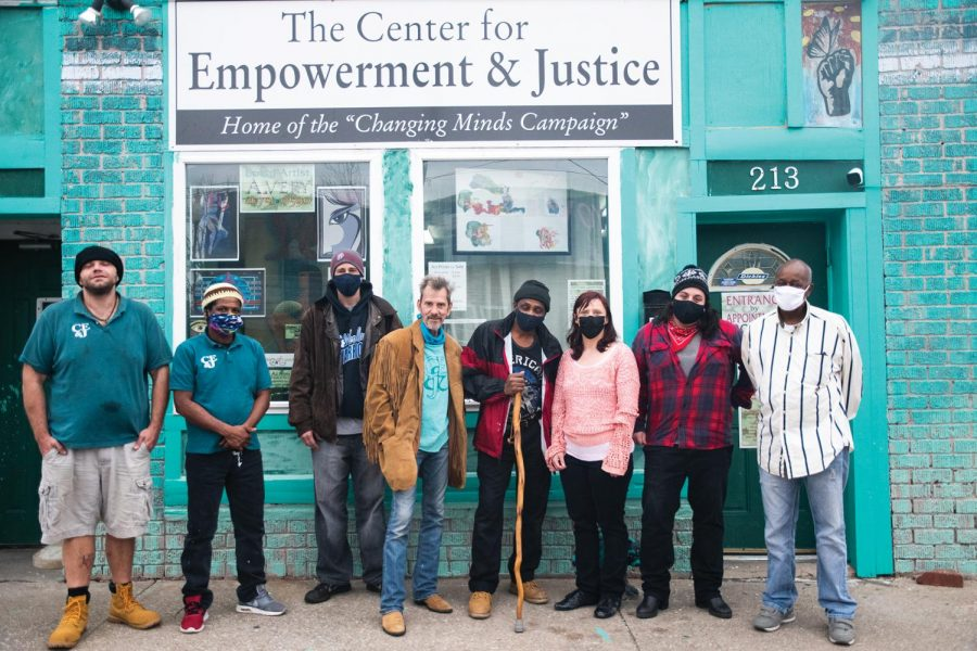 Volunteers and staff at the Center for Empowerment and Justice pose for a portrait outside the center on Thursday, Mar. 11, 2021 in Carbondale, Ill. The center was established in 2016 and has since been serving people to reform and overcome difficulties associated with being released from prison. The center offers artwork, a computer lab, and a workspace. The center has also become a shelter for homeless people in the Carbondale area. Monica Sharma | @mscli_cks