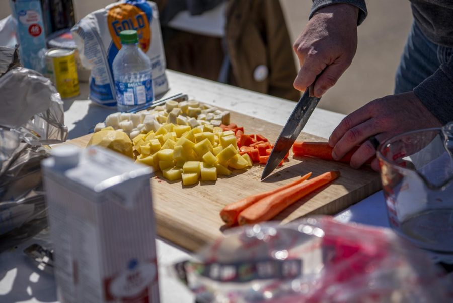 Joe Gray slices up a carrot to be put into his in-progress stew during the Irish Stew Cook-Off at the Murphysboro St. Patrick's Day Celebration on Saturday, March 20, 2021 in Murphysboro, Ill. This year, the events were scaled down compared to previous years due to the COVID-19 pandemic, but the Murphysboro Chamber of Commerce still put on events that could be enjoyed safely.