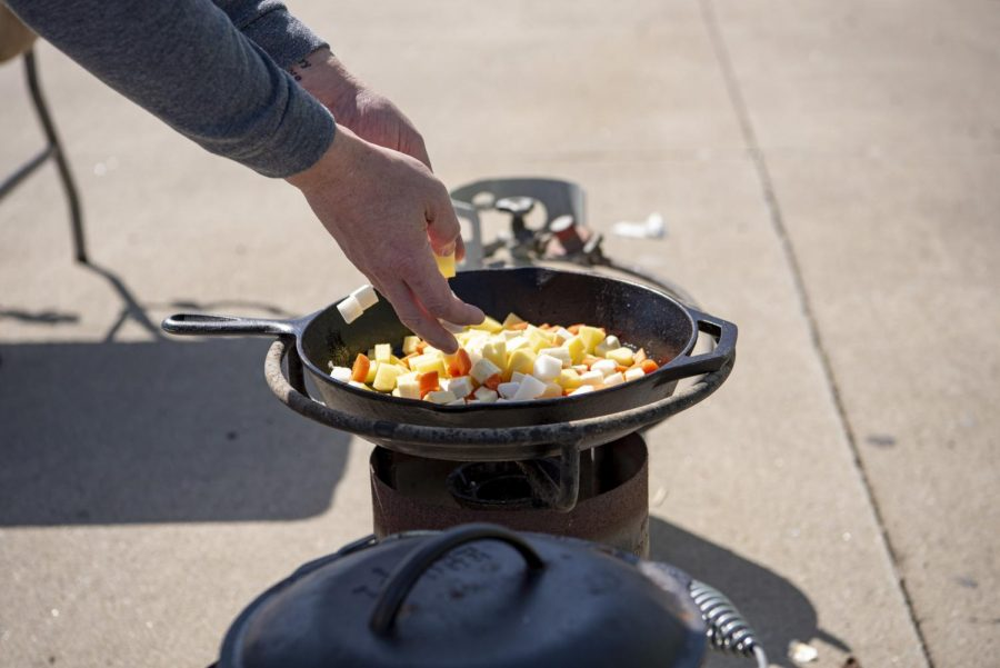 Joe Gray places an assortment of cut vegetables into a pan to be cooked before going into stew during the Irish Stew Cook-Off event during the Murphysboro St. Patrick's Day Celebration on Saturday, March 20, 2021 in Murphysboro.