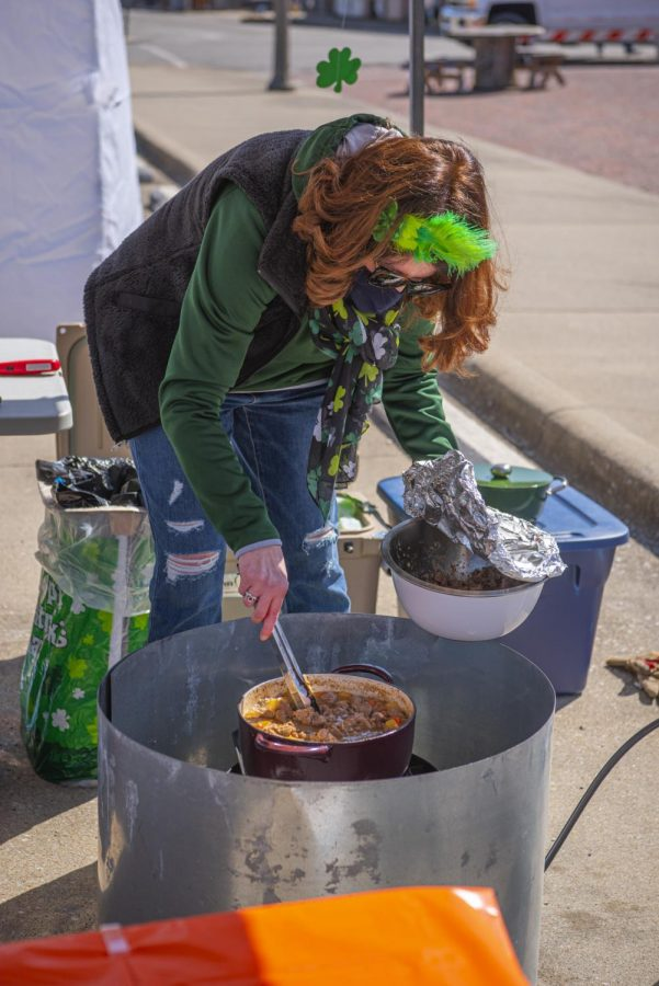 Angela Buss add meat to the stew during the Irish Stew Cook-Off at the Murphysboro St. Patrick's Day Celebration on Saturday, March 20, 2021, in Murphysboro, Ill.