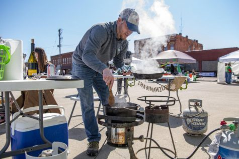Joe Gray takes a pan of cooked vegetables to add into his stew during the Irish Stew Cook-Off at the Murphysboro St. Patrick