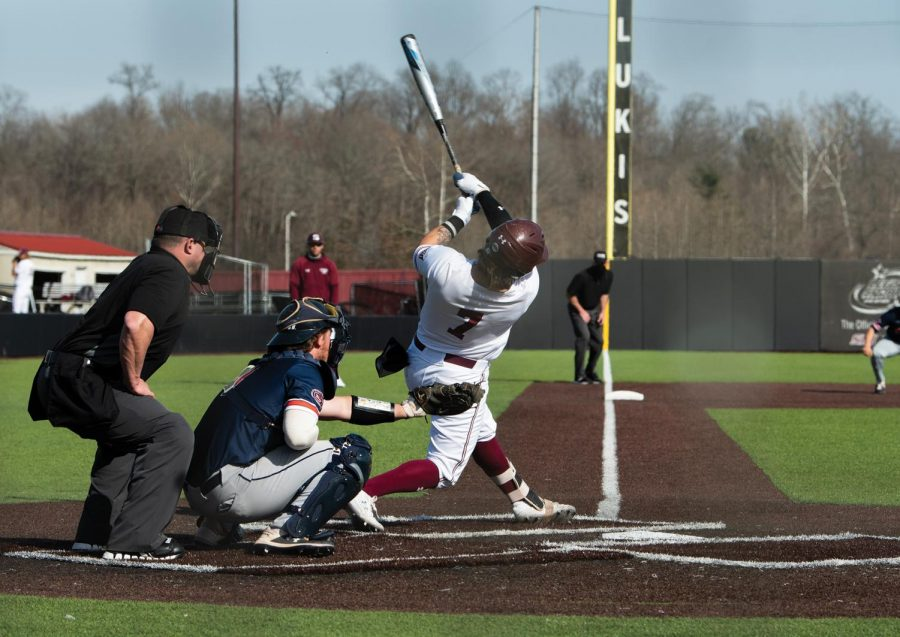Austin Ulick (7) hits the ball towards the center field in the game against University of Tennessee at Martin on Sunday, Mar. 7, 2021 at Itchy Jones Stadium in Carbondale Ill.