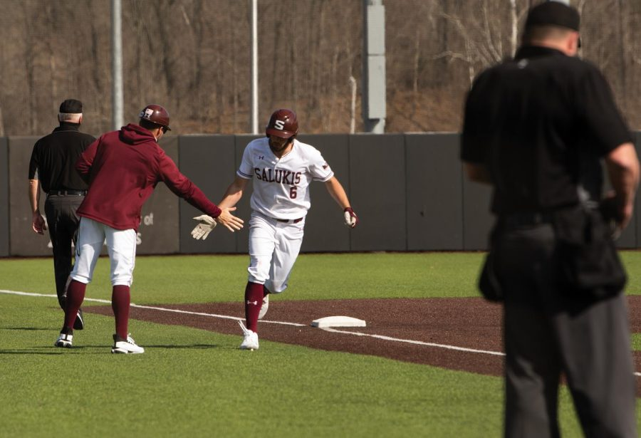 Tristen Peters (6) celebrates with a teammate after a home game against University of Tennessee at Martin on Sunday, Mar. 7, 2021 at Itchy Jones Stadium in Carbondale Ill.