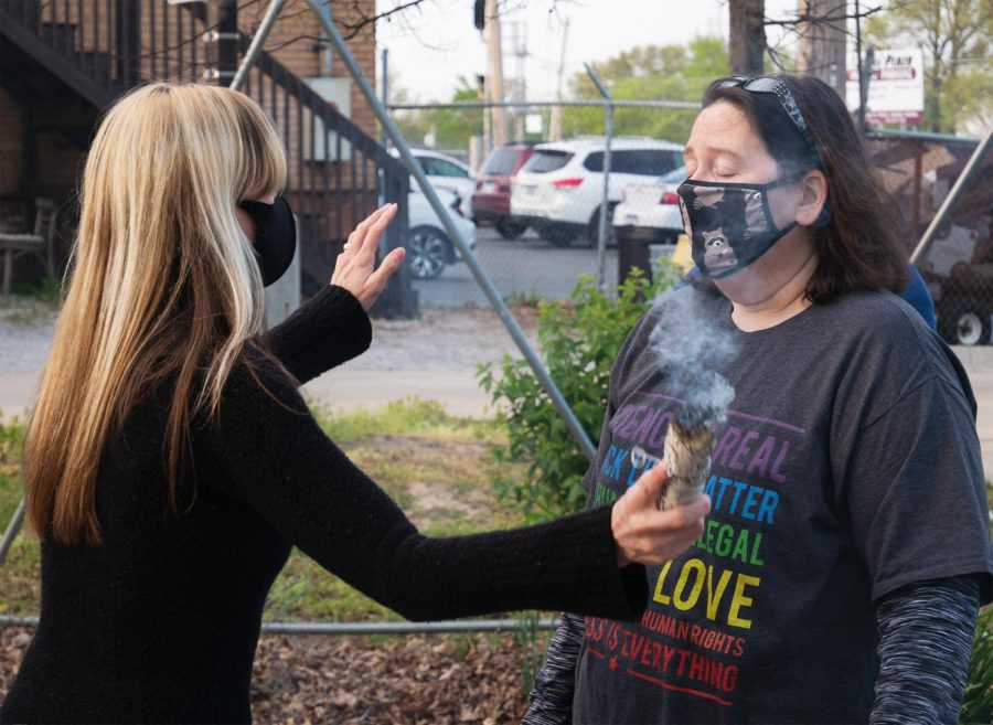 Tara Nelsen, leader of the Southern Illinois Pagan Alliance (SIPA), performs a smudging of rosemary ritual over SIPA member, Andy Darnelle, Wednesday, April 14, 2021, in Carbondale, Ill.