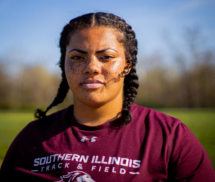 SIU thrower A'veun Moore-Jones poses for a portrait on Tuesday, April 6, 2021 at Lew Hartzog Track & Field Complex at SIU. Moore-Jones set a personal record during the Indoor Track season by throwing 55-feet at the Indiana State Invitational back in February.