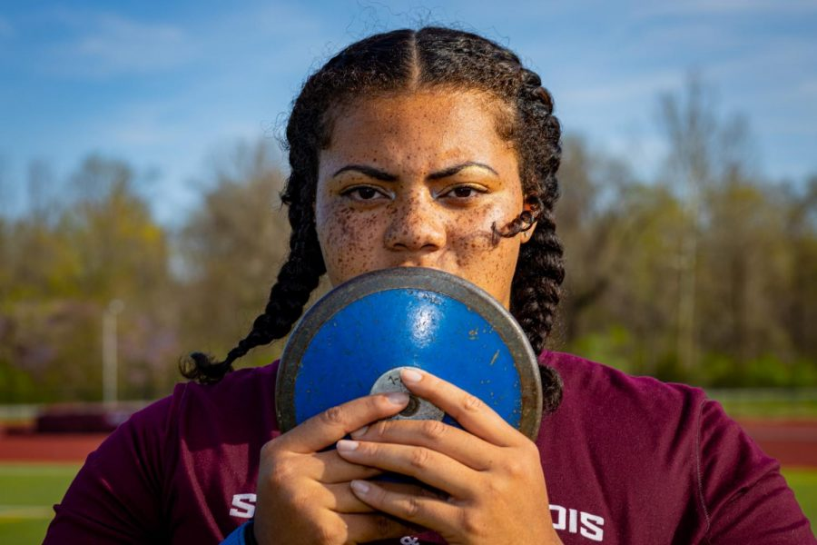 Senior thrower A'veun Moore-Jones poses with a discus on Tuesday, April 6, 2021 at Lew Hartzog Track & Field Complex at SIU. Moore-Jones was named All-MVC for a second time in her career and went on to take home first place in shot put at Missouri Valley Conference championship. After finishing 14th place in shot put at the NCAA Indoor Championships, she was named to the 2021 Second Team All-American status.
