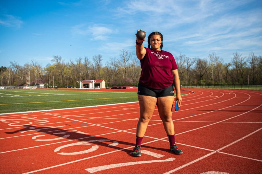 SIU thrower A'veun Moore-Jones poses with a shot put and discus on Tuesday, April 6, 2021 at Lew Hartzog Track & Field Complex at SIU. Moore-Jones set a personal record during the Indoor Track season by throwing 55-feet at the Indiana State Invitational back in February.