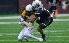 Jonathan Thompson, cornerback, tackles a Southeastern Louisiana University player on Saturday, April, 17, 2021 in Carbondale, Ill.
