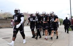The SIU Salukis walk to the stadium on Saturday, April, 17, 2021 for the game against Southeastern Louisiana University in Carbondale, Ill.