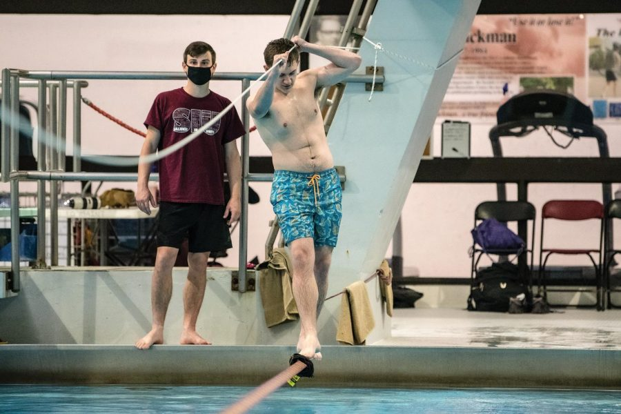 "Joshua Virella, an undergraduate student in the Physics Department, tries to balance on the rope at the April Pools Day event Thursday, April 1, 2021, at SIU Recreation Center in Carbondale, Ill. ""I am here with my friend and we are enjoying it a lot after a long time,"" Virella said."