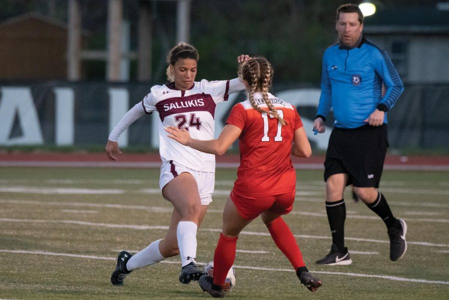 Maya Warrior (24) dribbles the ball to get past the opponent midfielder in the game against Illinois State University on Saturday, April 3, 2021 at Lew Hartzog Track and Field Complex in Carbondale, Ill.