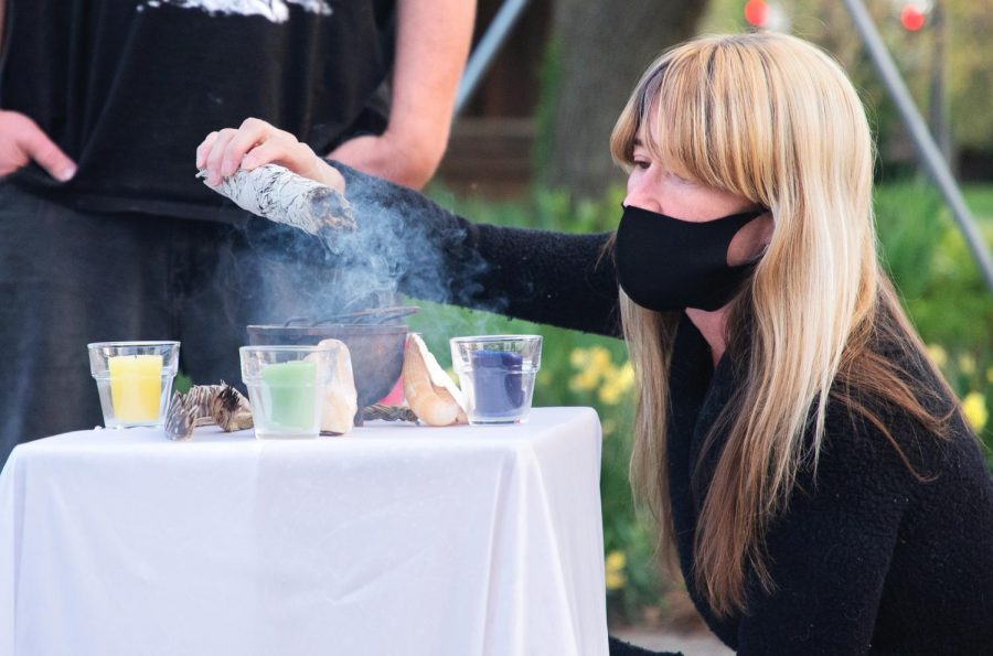 Tara Nelson, the leader of Southern Illinois Pagan Alliance (SIPA), burns the rosemary smudge before a smudging ritual on Wednesday April 14, 2021, inside the Labyrinth near Gaia House Interfaith Center, in Carbondale Ill. Smudging rituals is believed to clear the negative energy from the people.