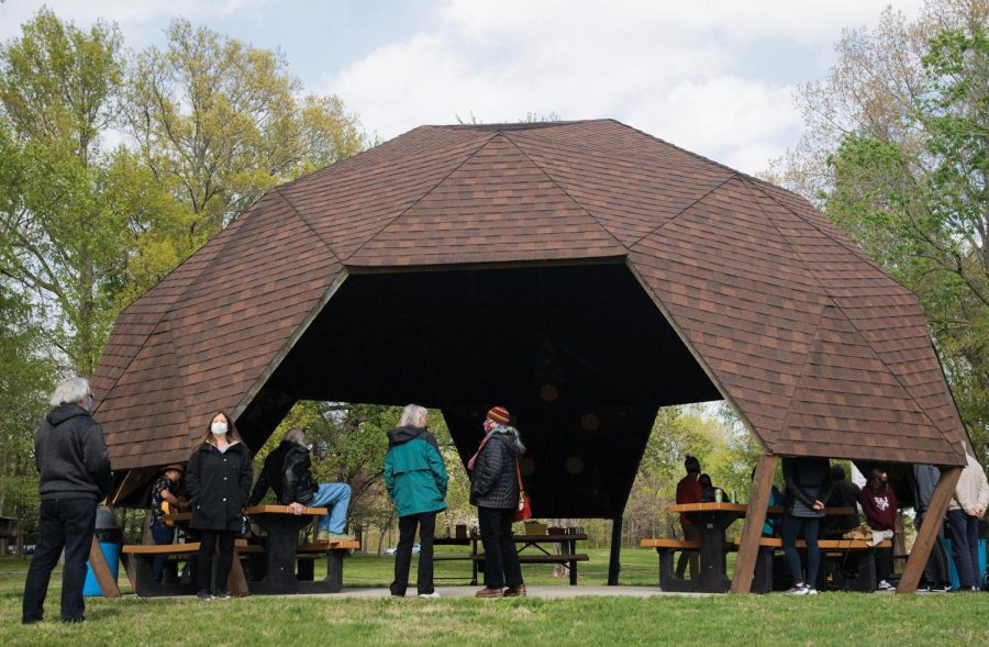 People engage and talk about the program at Bucky's Haven on Wednesday, April 21, 2021, near Campus Lake, in Carbondale, Ill.
