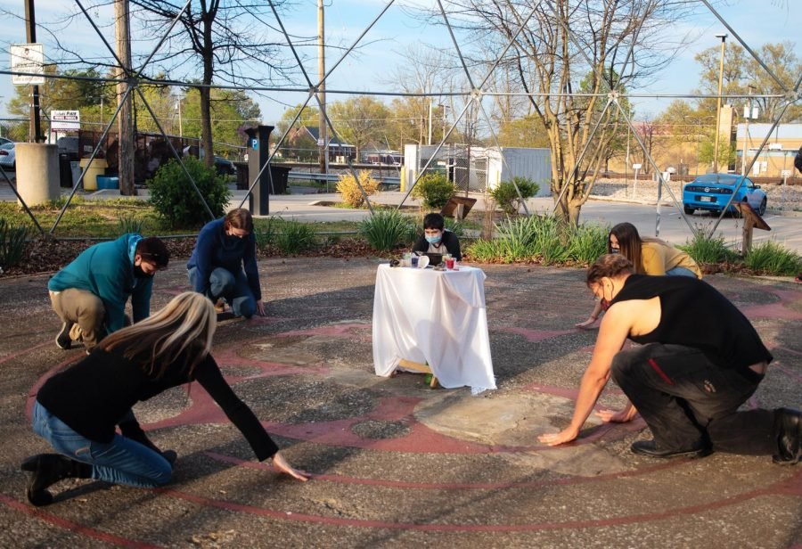 """Members of Southern Illinois Pagan Alliance (SIPA) bow to the ground after ending the smudging ritual  on Wednesday April 14, 2021, inside the Labyrinth near Gaia House Interfaith Center, in Carbondale Ill. """"We used to perform major events at least 8 times a year but, after the pandemic hit, we didn't do it for a complete year,"""" Tara Nelson, the leader of SIPA, said."""