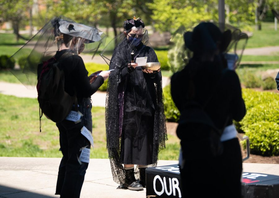 Cade Brusell, professor and a member of the collective, participates in the funeral and guides in honor of countless species of animals that have gone extinct on Thursday, April 22, 2021 at the Communications Building in Carbondale, Ill.
