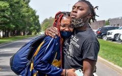 """15-year-old Marion track athlete Amari Tucker, is comforted by her brother Malik when seeing the size of the protest at Marion High School on Monday, April 26, 2021. Tucker was asked to turn in her uniform by her coach, Sara Baker, after complaining that Baker allegedly called her a """"Black barefooted African from the third world"""" in front of her teammates."""