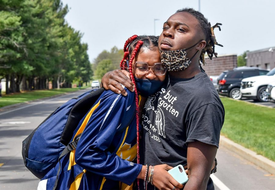 "15-year-old Marion track athlete Amari Tucker, is comforted by her brother Malik when seeing the size of the protest at Marion High School on Monday, April 26, 2021. Tucker was asked to turn in her uniform by her coach, Sara Baker, after complaining that Baker allegedly called her a ""Black barefooted African from the third world"" in front of her teammates."