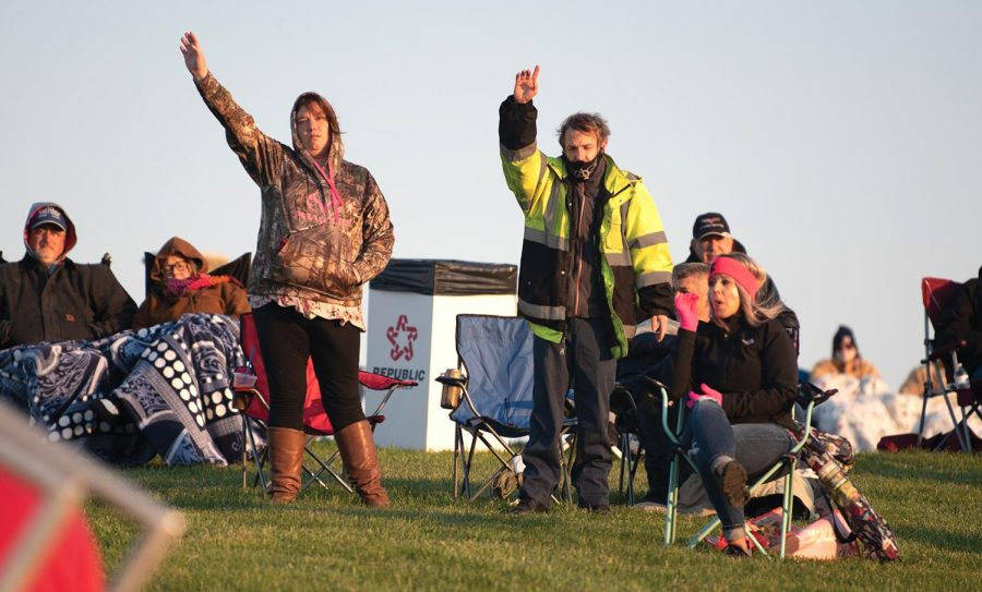 People raise their hands during Easter Sunrise Service at Bald Knob Cross on Sunday, April 4, 2021 in Alto Pass, Ill.