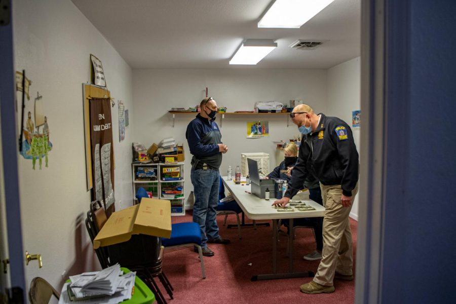 Decatur police officers sit in a room inside the Community Church of God Friday, April 2, 2021 in Decatur, Ill.