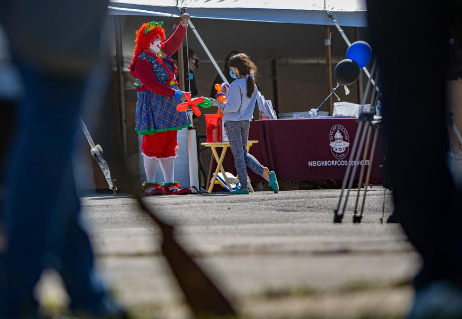 Sally the Clown hands out balloon animals on Friday, April 2, 2021 in Decatur, Ill.