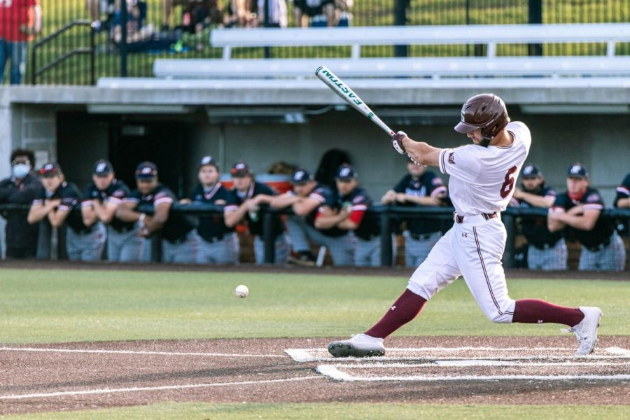 Tristan Peters (6) hits the ball in a game against Austin Peay State University Tuesday, April 6, 2021 at SIU.