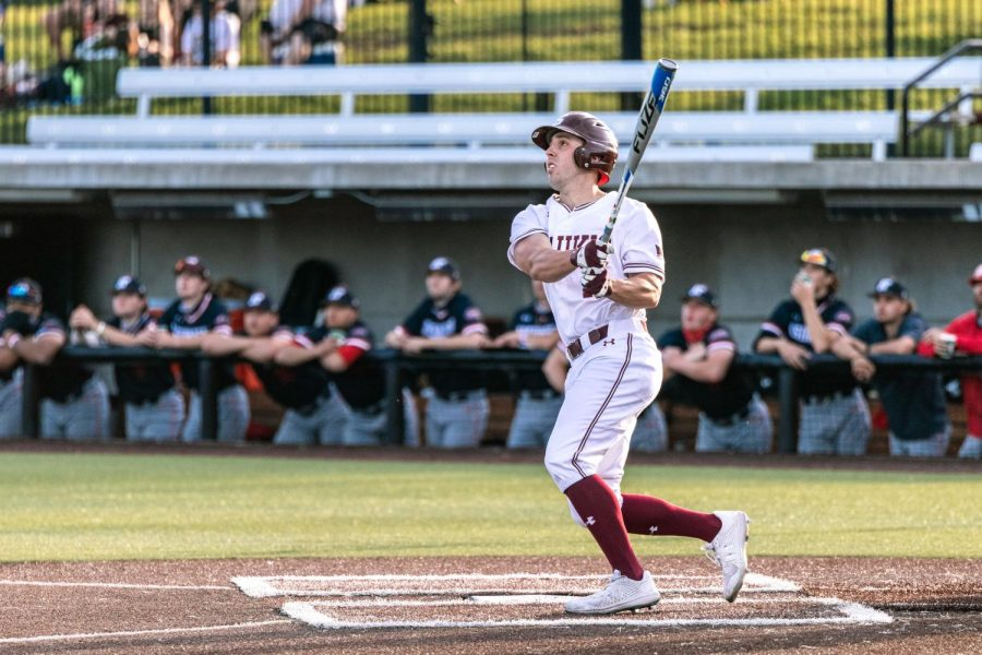 Vinni Massaglia (10) hits a home run in a game against Austin Peay State University Tuesday, April 6, 2021 at SIU. Massaglia's home run during the first inning allowed himself, as well as Nick Neville (9) to score for the Salukis.